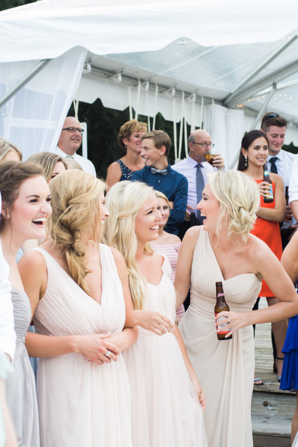 bridesmaids-laughing-mismatched-dresses http://itgirlweddings.com/seaside-florida-wedding/