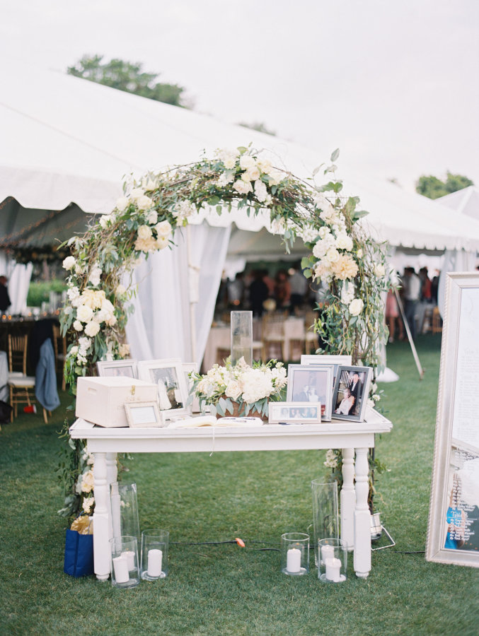 wedding-welcome-table-with-family-photos-floral-arch http://itgirlweddings.com/seaside-florida-wedding/