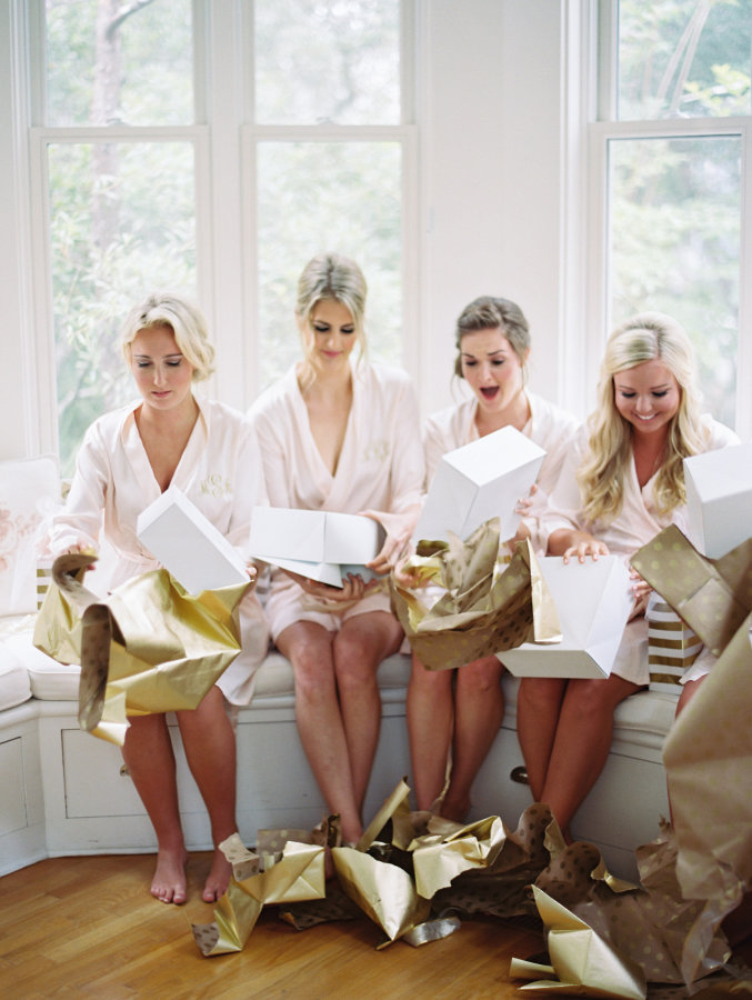 bridesmaids-opening-up-gifts-from-bride http://itgirlweddings.com/seaside-florida-wedding/