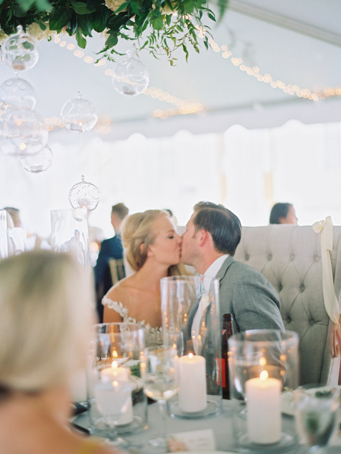 bride-and-groom-kissing-at-reception http://itgirlweddings.com/seaside-florida-wedding/