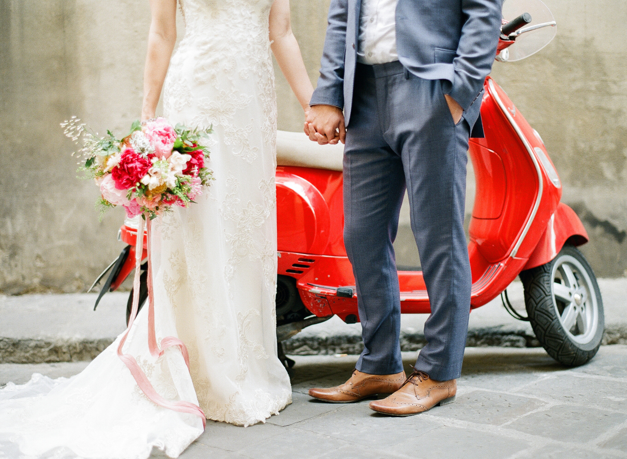 bride-groom-moped http://itgirlweddings.com/everything-need-know-plan-wedding-abroad/