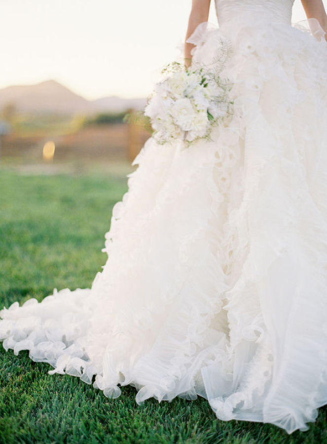 a line wedding dress with tulle http://itgirlweddings.com/modern-napa-valley-wedding/