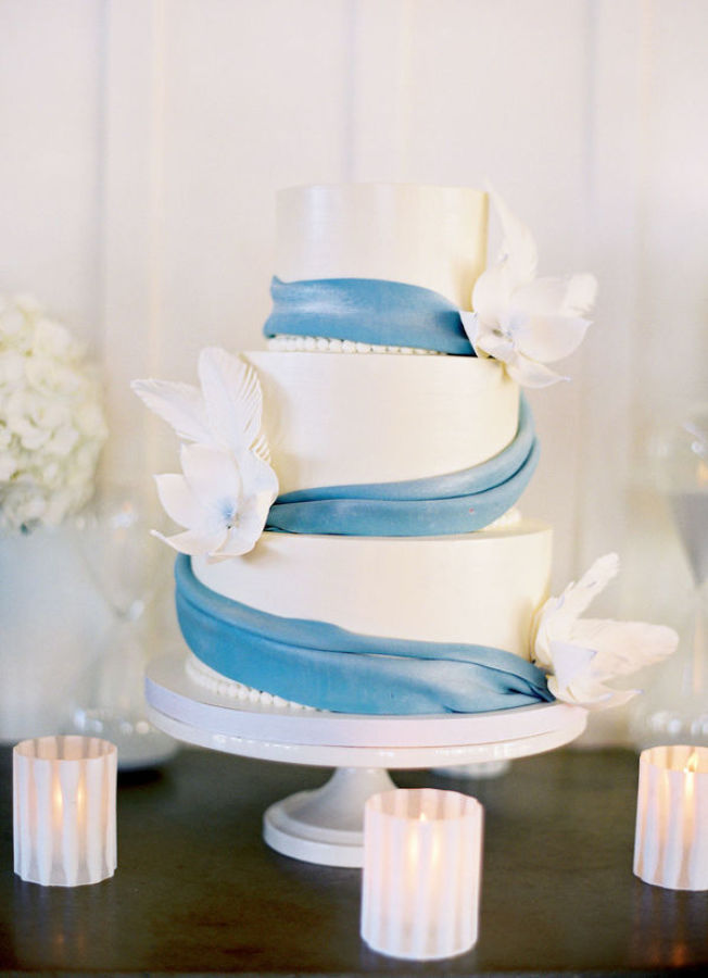white cake with blue ribbon http://itgirlweddings.com/modern-napa-valley-wedding/