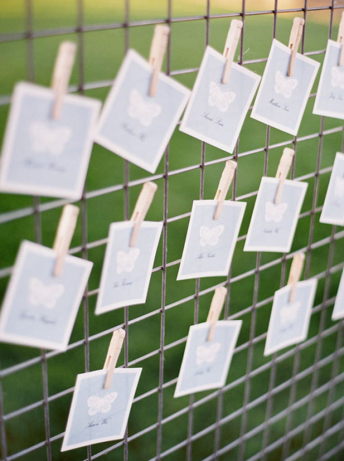 place cards hung on wire http://itgirlweddings.com/modern-napa-valley-wedding/
