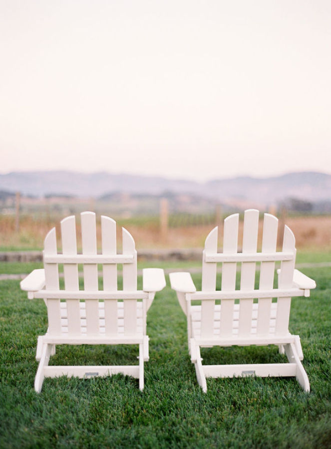 two white chairs overlooking vineyard http://itgirlweddings.com/modern-napa-valley-wedding/