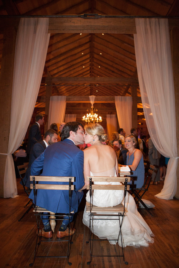 kiss kiss at wedding reception http://itgirlweddings.com/romantic-mountain-wedding/