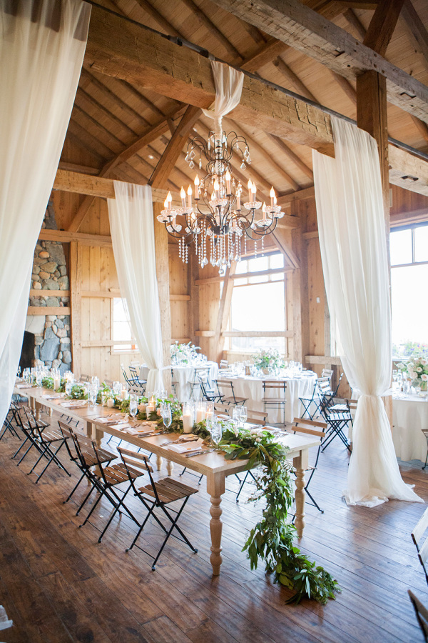 rustic wedding reception with greenery and curtains http://itgirlweddings.com/romantic-mountain-wedding/
