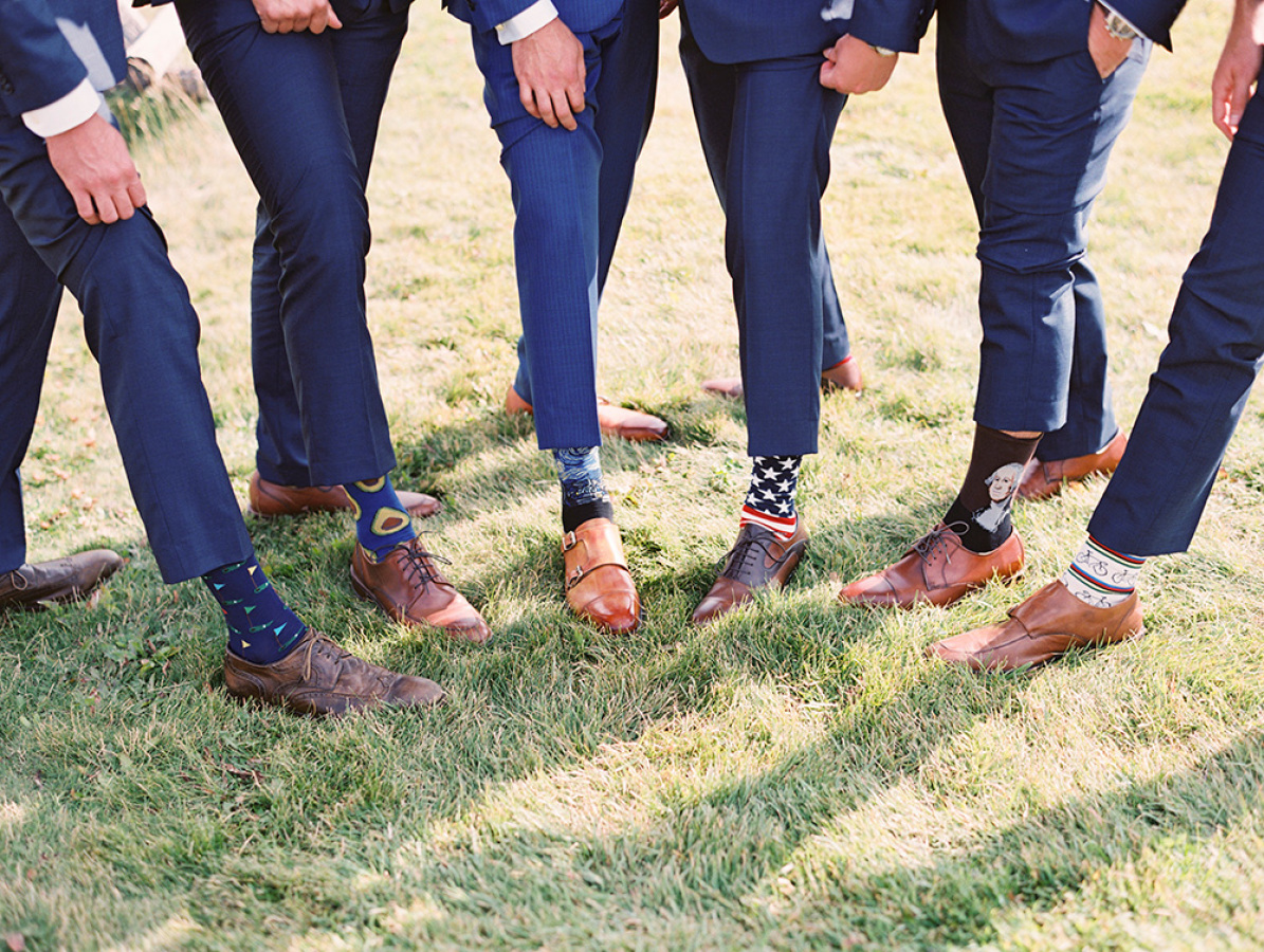 groomsmen with mismatched socks http://itgirlweddings.com/romantic-mountain-wedding/