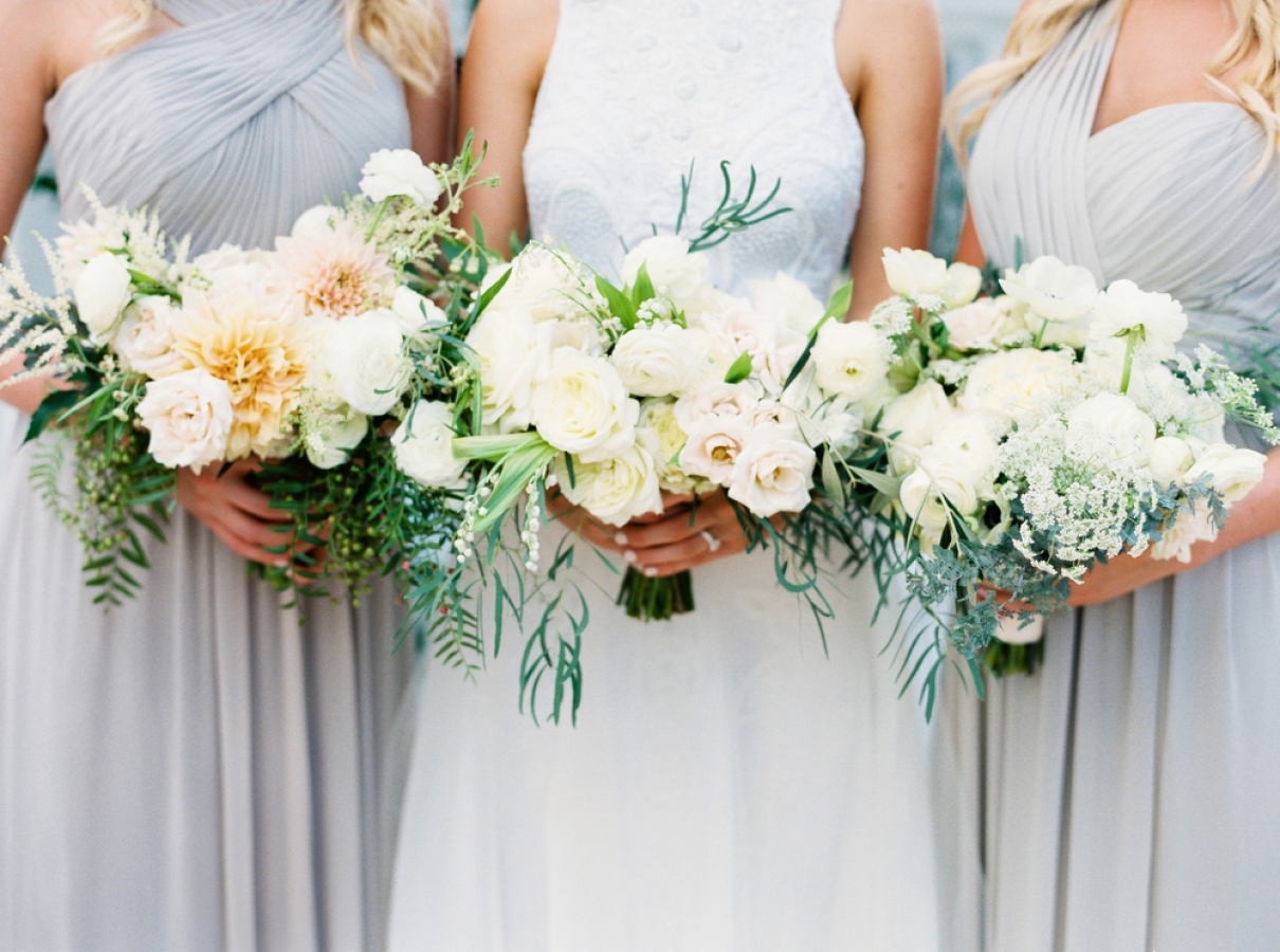bridesmaids in grey dresses holding ivory flowers http://itgirlweddings.com/timeless-traditional-style/