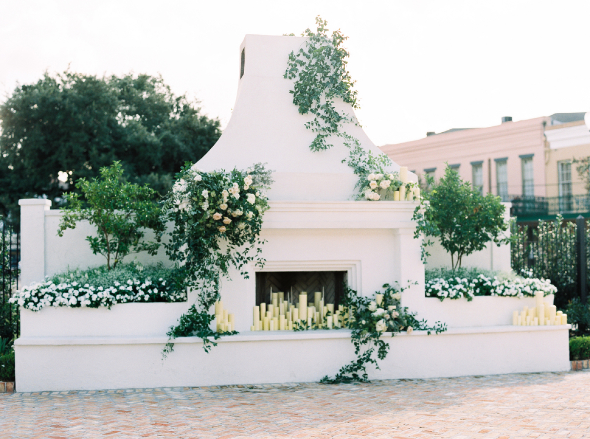 outdoor fireplace with candles http://itgirlweddings.com/timeless-traditional-style/