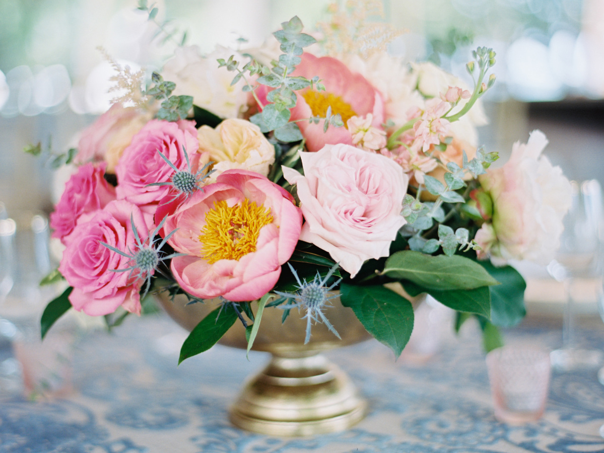 pink blush flower arrangement http://itgirlweddings.com/southern-wedding-with-a-surprise-grand-exit/