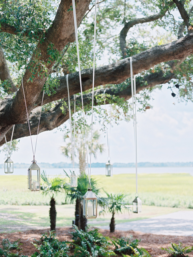 hanging hurricane candles http://itgirlweddings.com/southern-wedding-with-a-surprise-grand-exit/