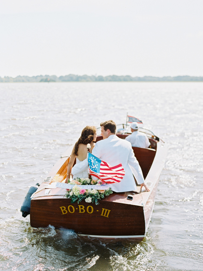bride and groom on a boat http://itgirlweddings.com/southern-wedding-with-a-surprise-grand-exit/