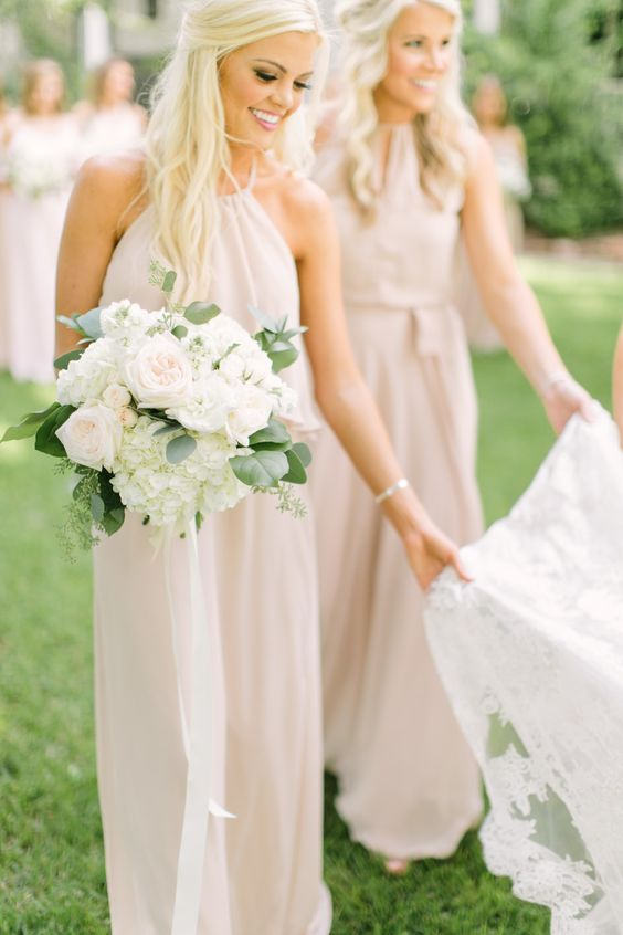 bridesmaids fixing wedding dress http://itgirlweddings.com/5-ways-save-money-bridesmaid/