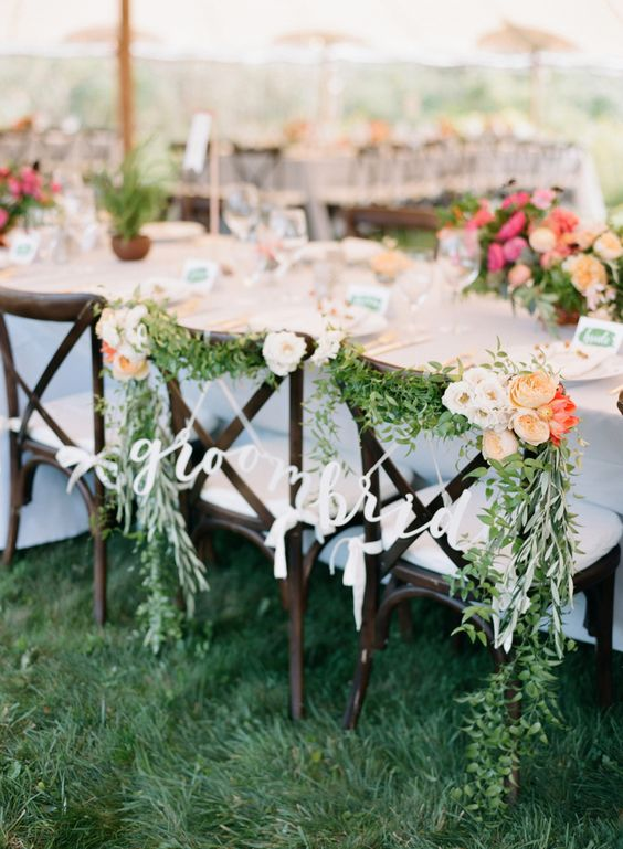 groom and bride chair signs http://itgirlweddings.com/how-to-master-an-outdoor-wedding/
