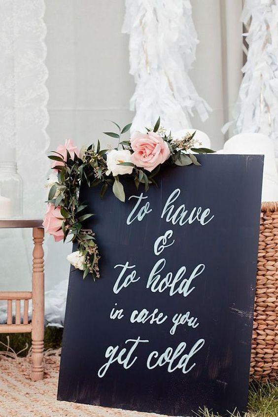 to have and to hold in case you get cold sign http://itgirlweddings.com/how-to-master-an-outdoor-wedding/