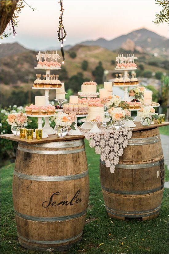 wedding dessert table on wine barrels http://itgirlweddings.com/how-to-master-an-outdoor-wedding/