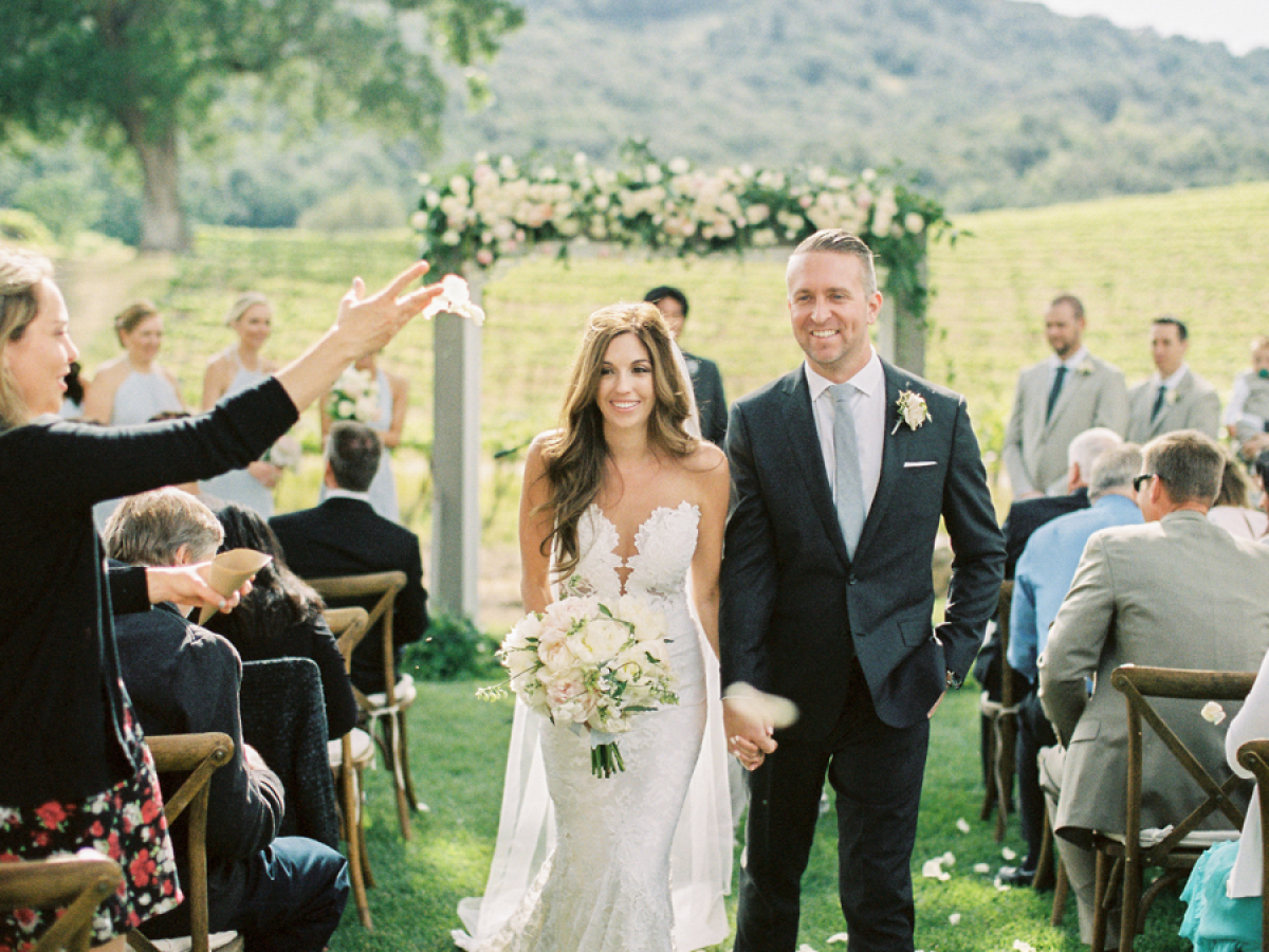 bride and groom walking down the aisle at vineyard wedding http://itgirlweddings.com/pretty-vineyard-wedding/