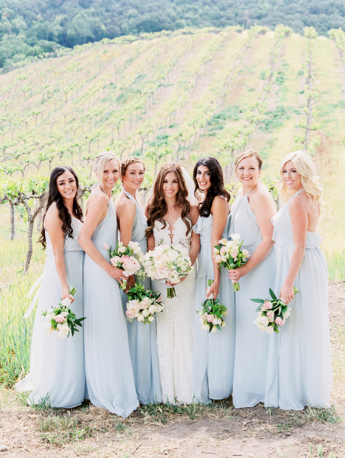 bridesmaids in pale blue wedding dresses http://itgirlweddings.com/pretty-vineyard-wedding/