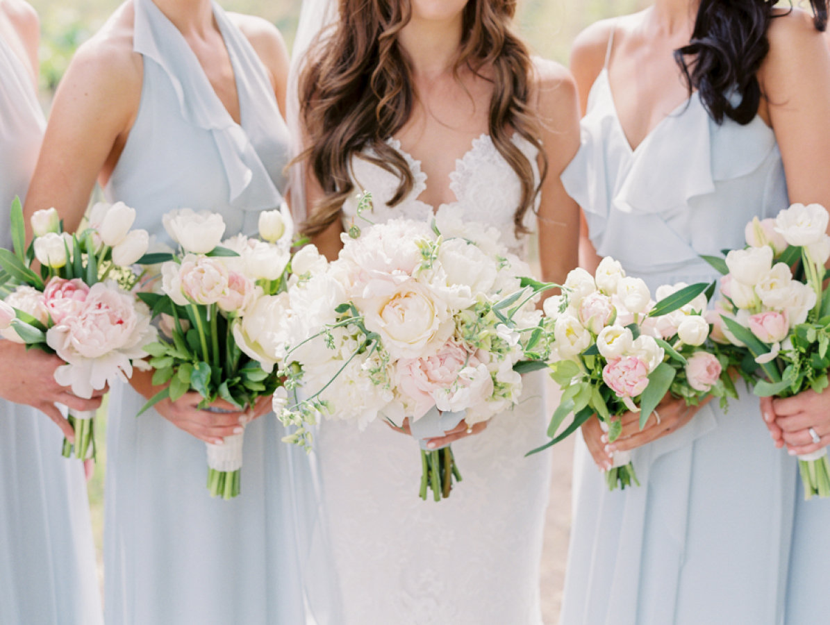 pale blue bridesmaids dresses white florals http://itgirlweddings.com/pretty-vineyard-wedding/