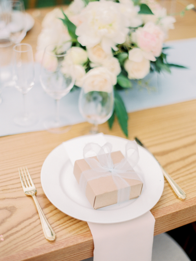 presents at wedding reception table http://itgirlweddings.com/pretty-vineyard-wedding/