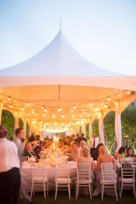 wedding marquee tent with edison lights http://itgirlweddings.com/how-to-master-an-outdoor-wedding/