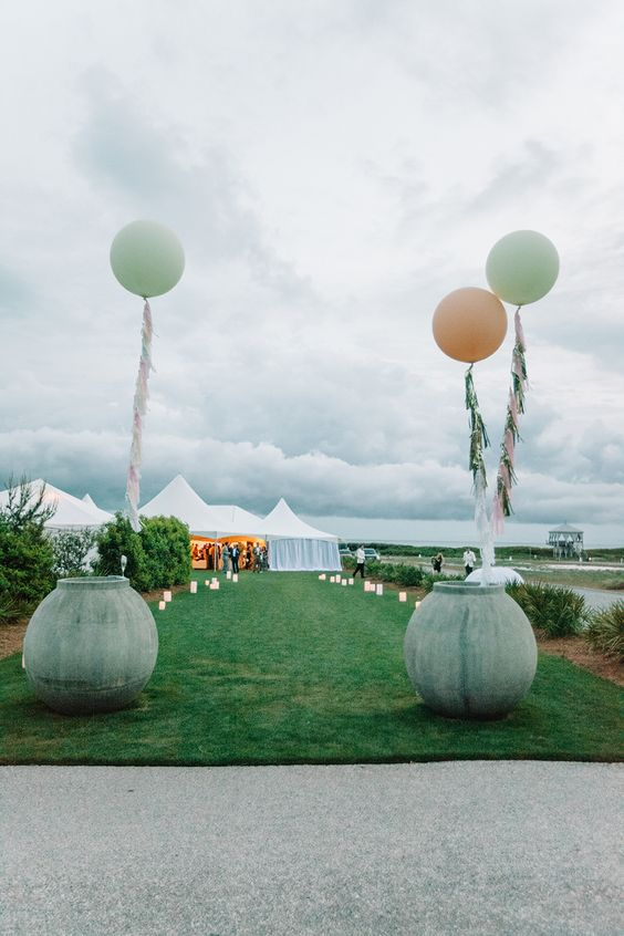 wedding tassel balloons http://itgirlweddings.com/how-to-master-an-outdoor-wedding/