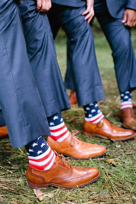 groomsmen matching american flag socks http://itgirlweddings.com/who-is-responsible-for-what-on-your-wedding-day/