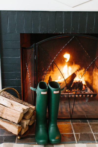 hunter boots by the fire http://itgirlweddings.com/5-halloween-date-night-ideas/