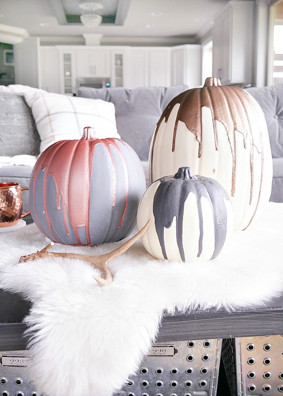 pink and white painted pumpkins http://itgirlweddings.com/5-halloween-date-night-ideas/