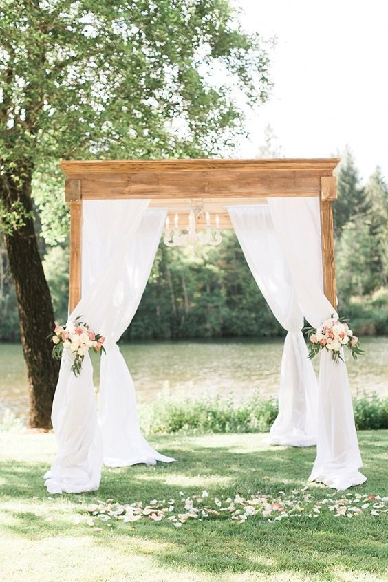 wedding arbor with curtains, groom planning