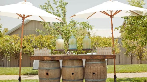 wedding ceremony wine barrel lemonade stand http://itgirlweddings.com/create-vignettes-wedding/