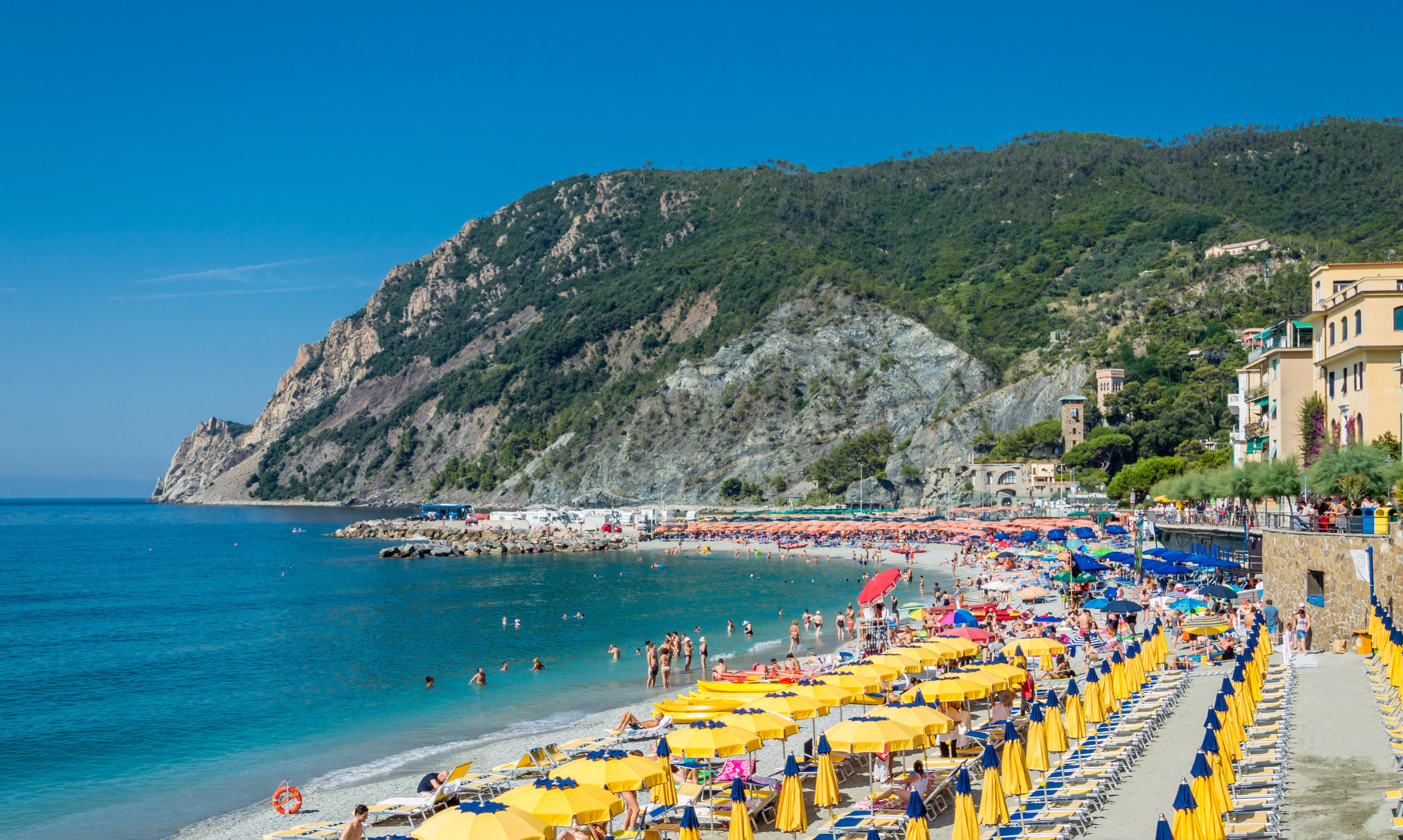 cinque-terre-umbrellas http://itgirlweddings.com/4-things-consider-before-jetting-off-your-honeymoon/