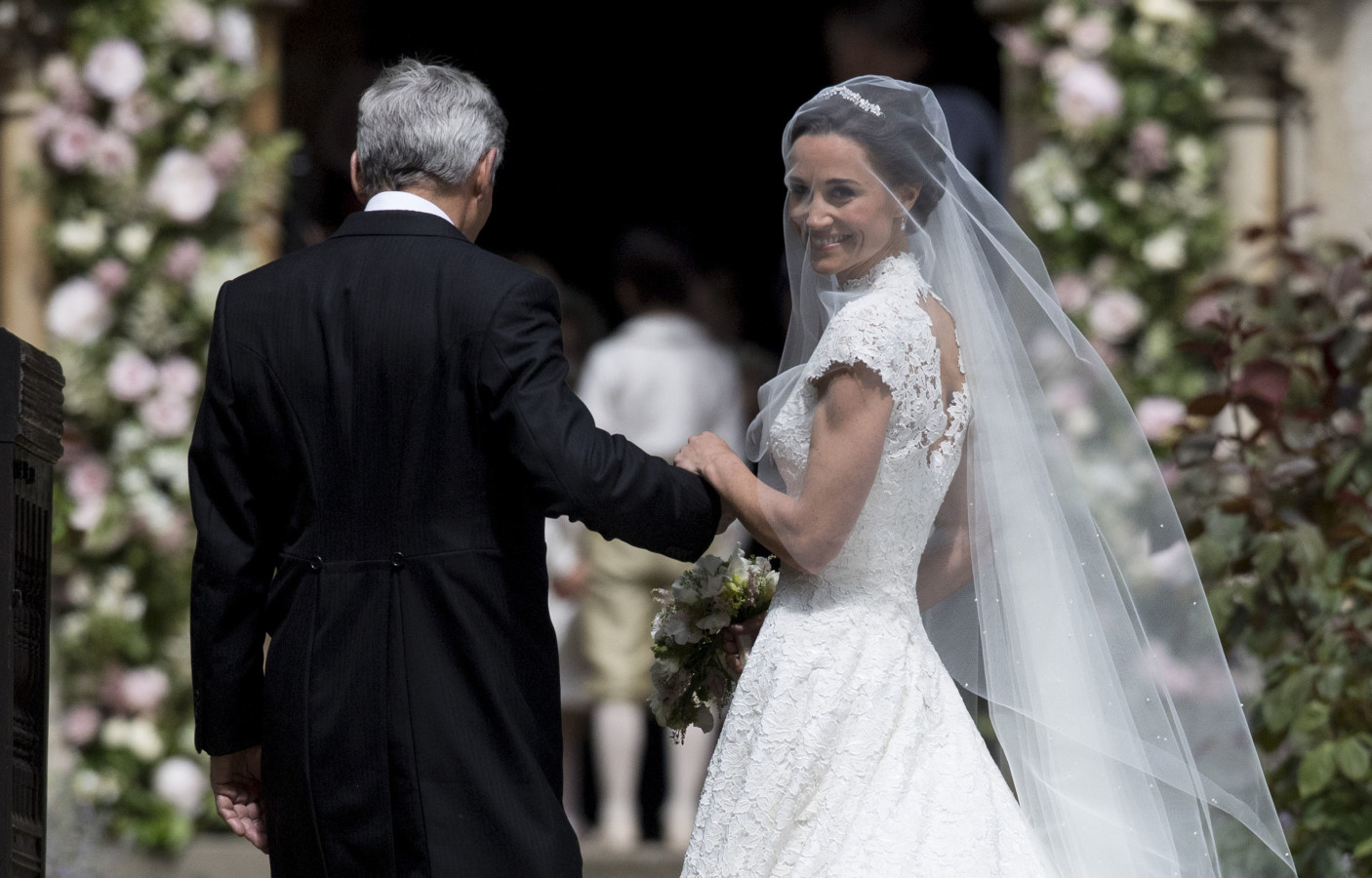 Pippa Middleton and father at her wedding