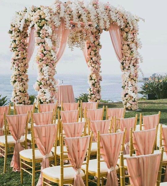 wedding arbor covered in flowers