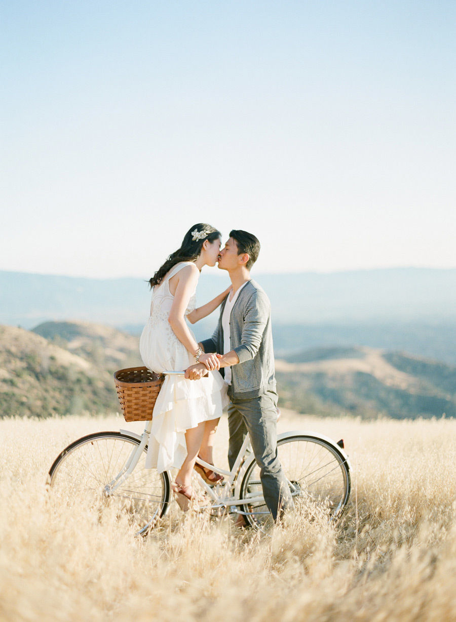 engagement photos on a bike