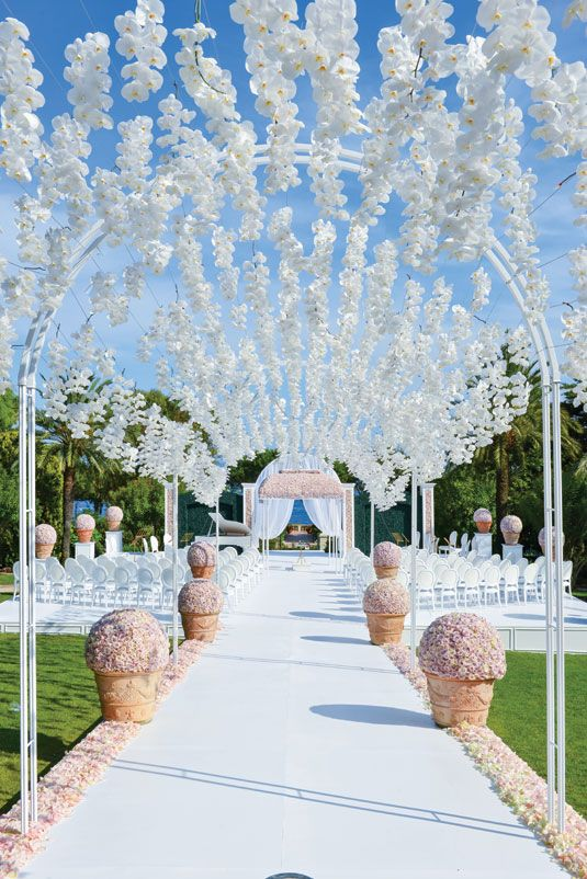 hanging wedding flowers over the aisle