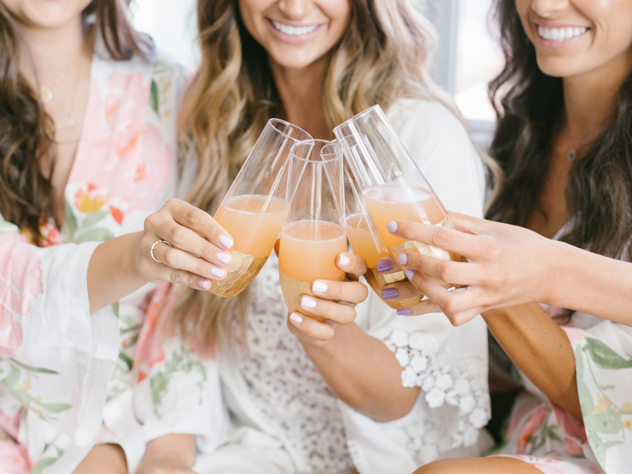 bridesmaids toasting in robes
