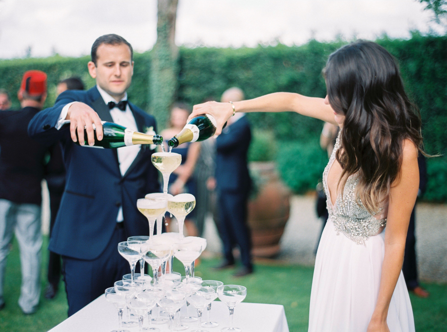 bride and groom pouring champagne