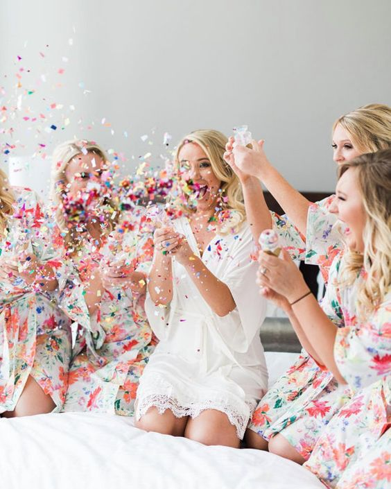 bridesmaids floral robes with confetti