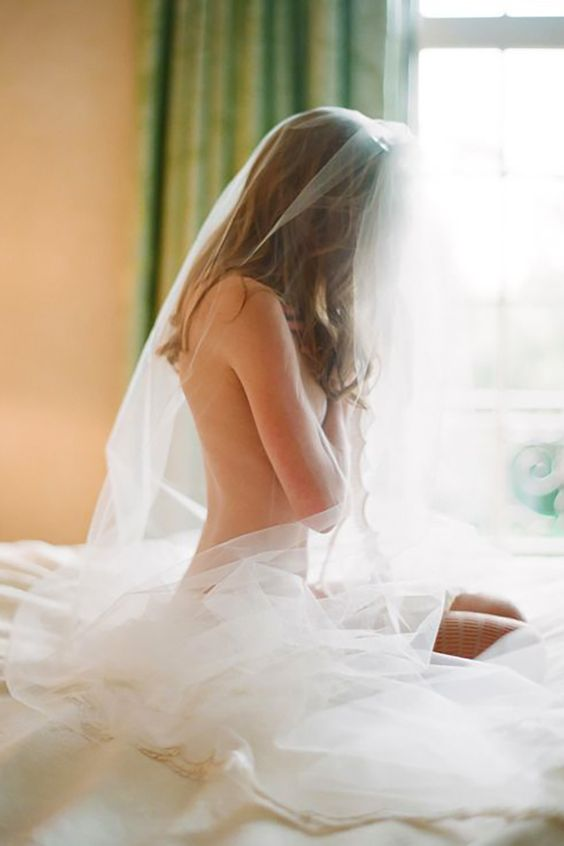 naked boudoir shot with wedding veil