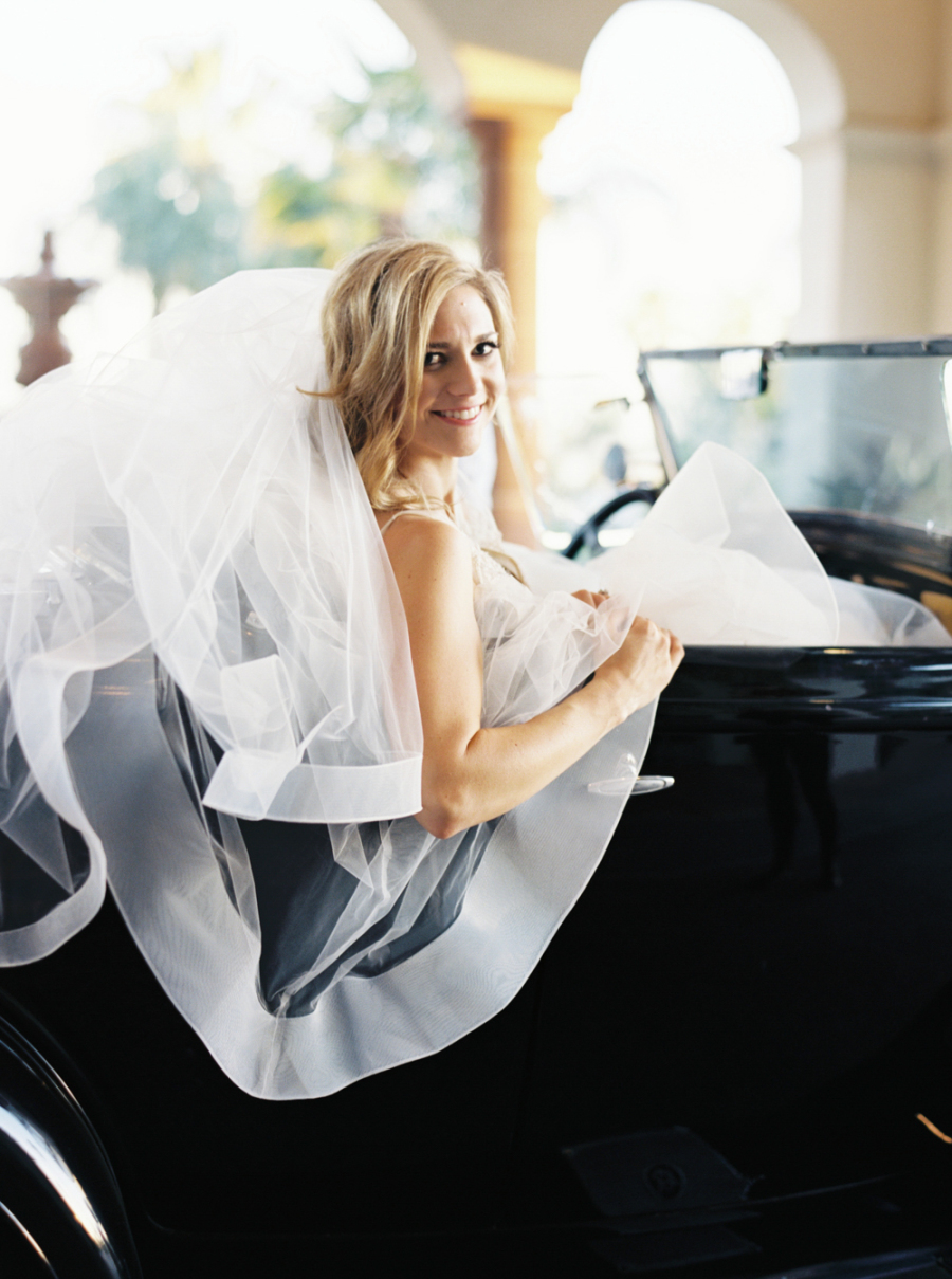 bride in vintage car with veil