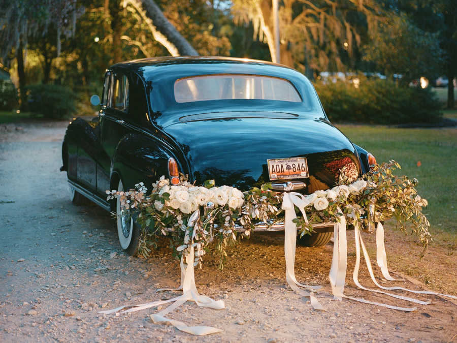 vintage car with flowers at rear