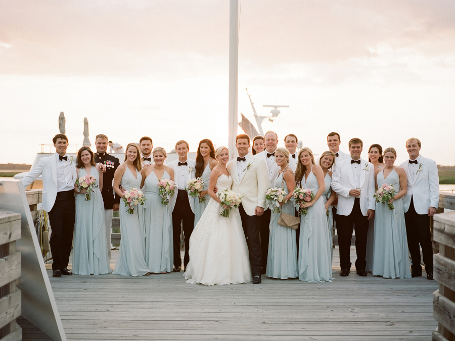 white tie wedding suits and light blue bridesmaids dresses