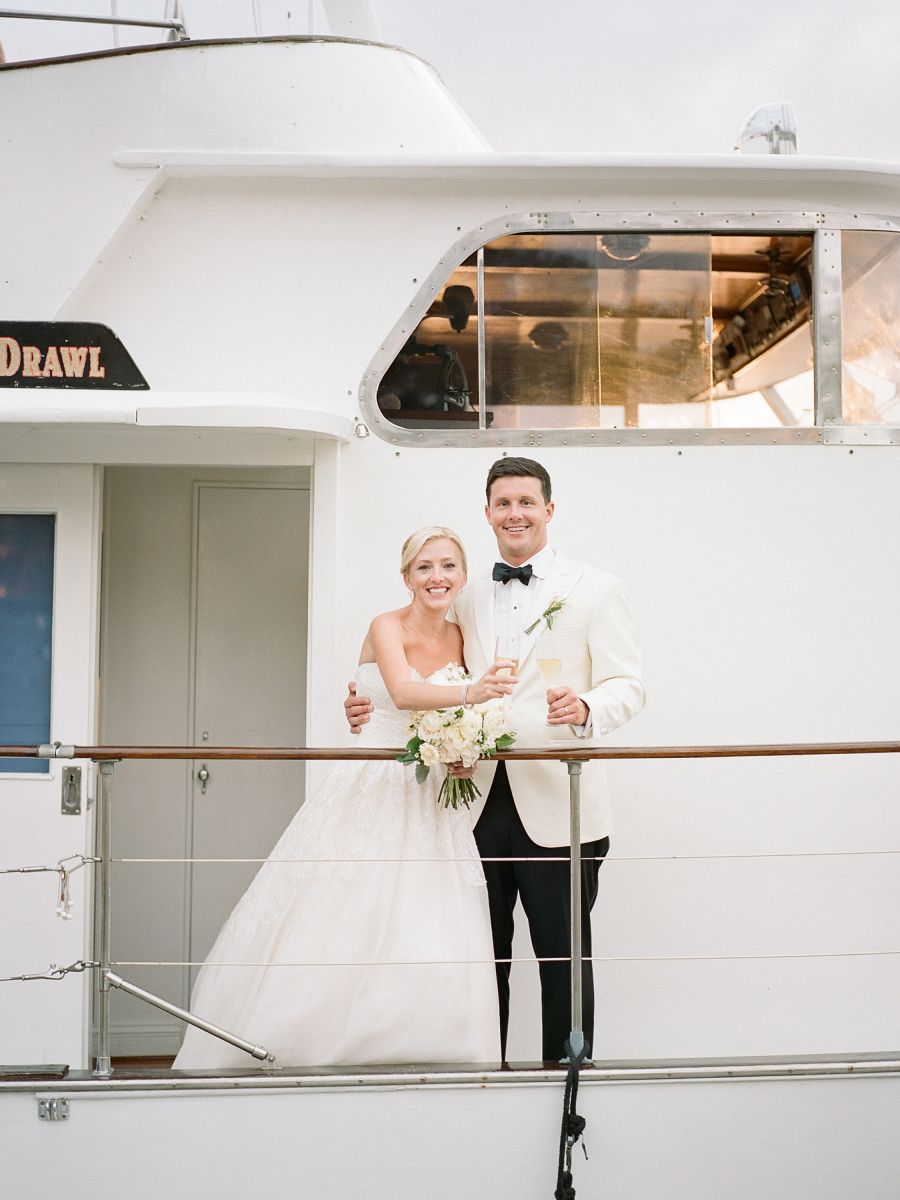 bride and groom boat champagne toast