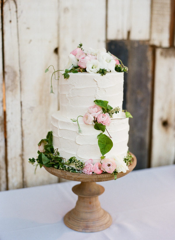white wedding cake with pink and white flowers