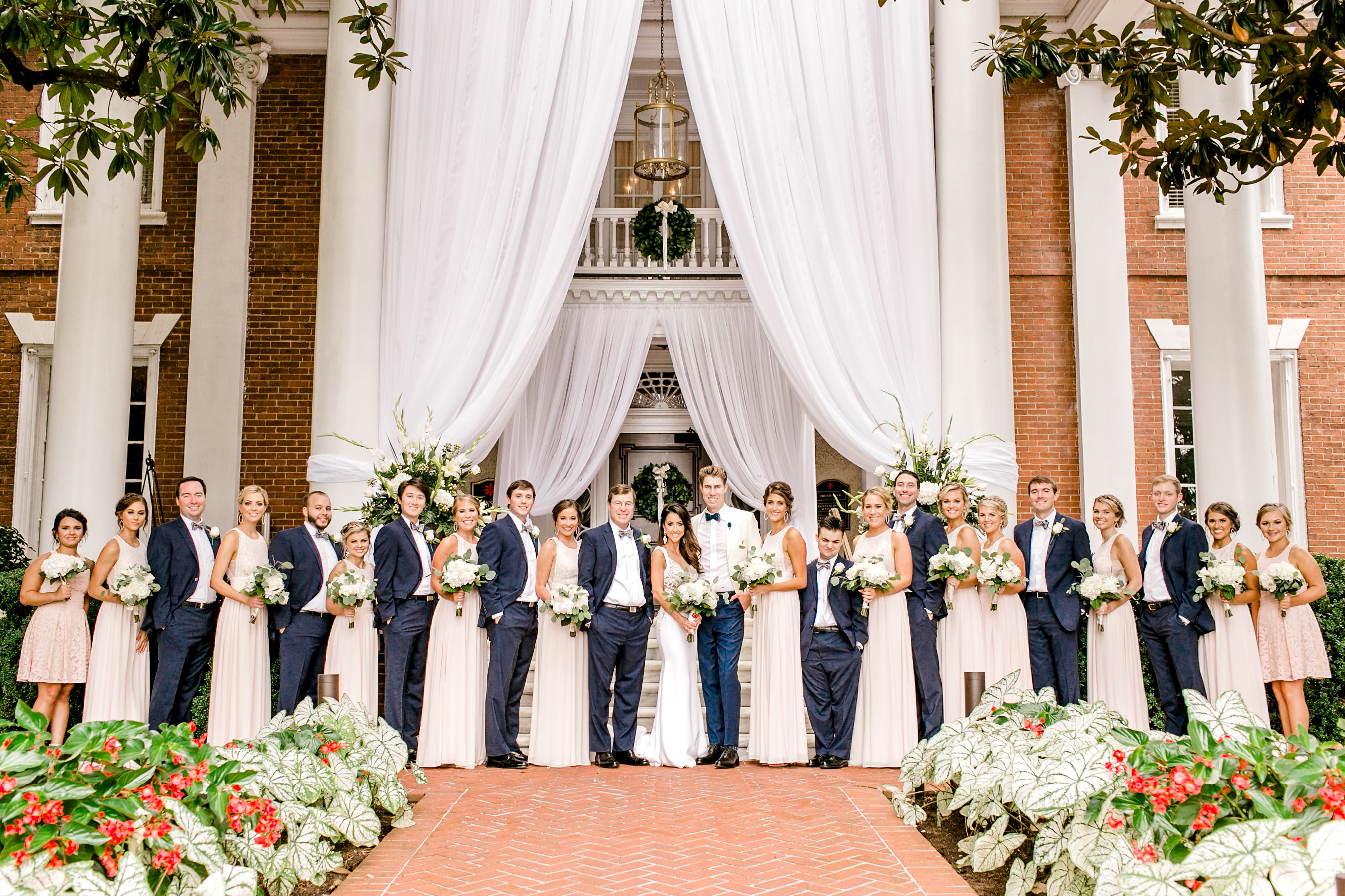 blush bridesmaids and groomsmen in navy suites