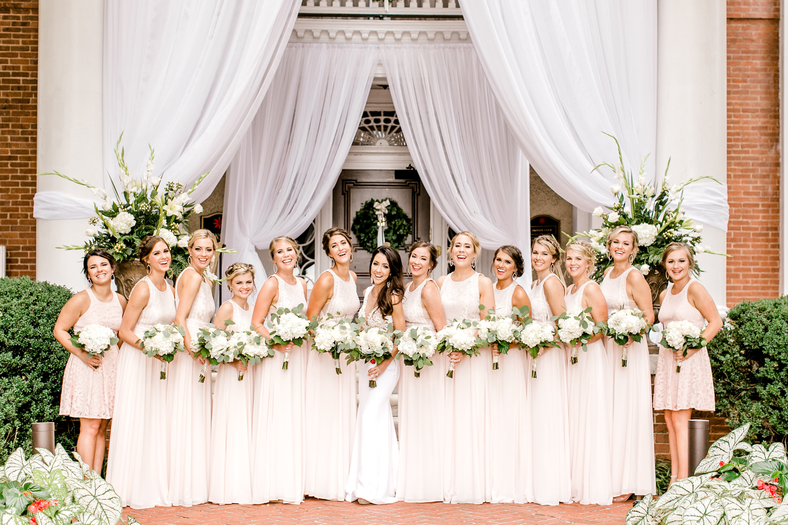 wedding curtains behind bridesmaids