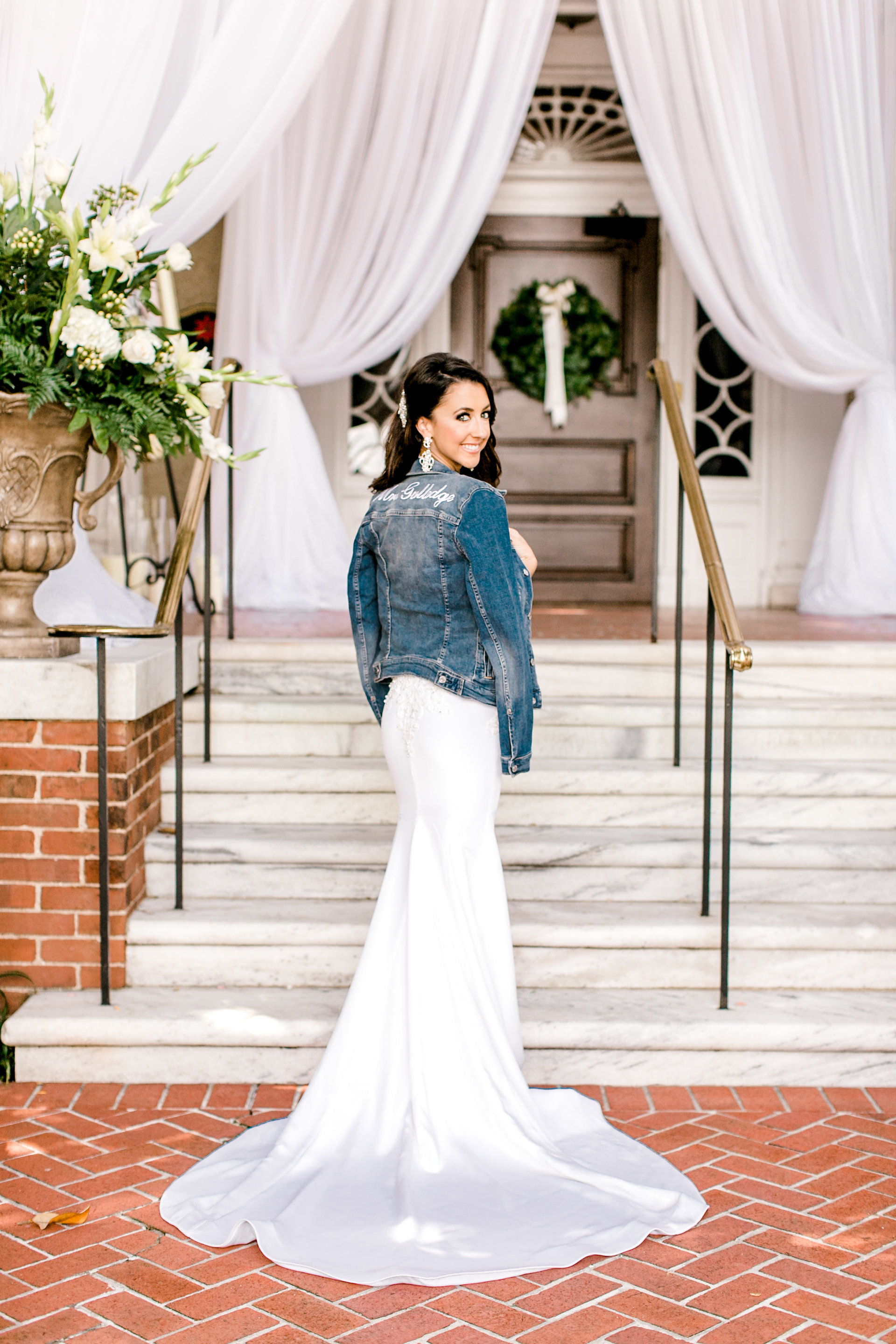 bride wearing jeans jacket