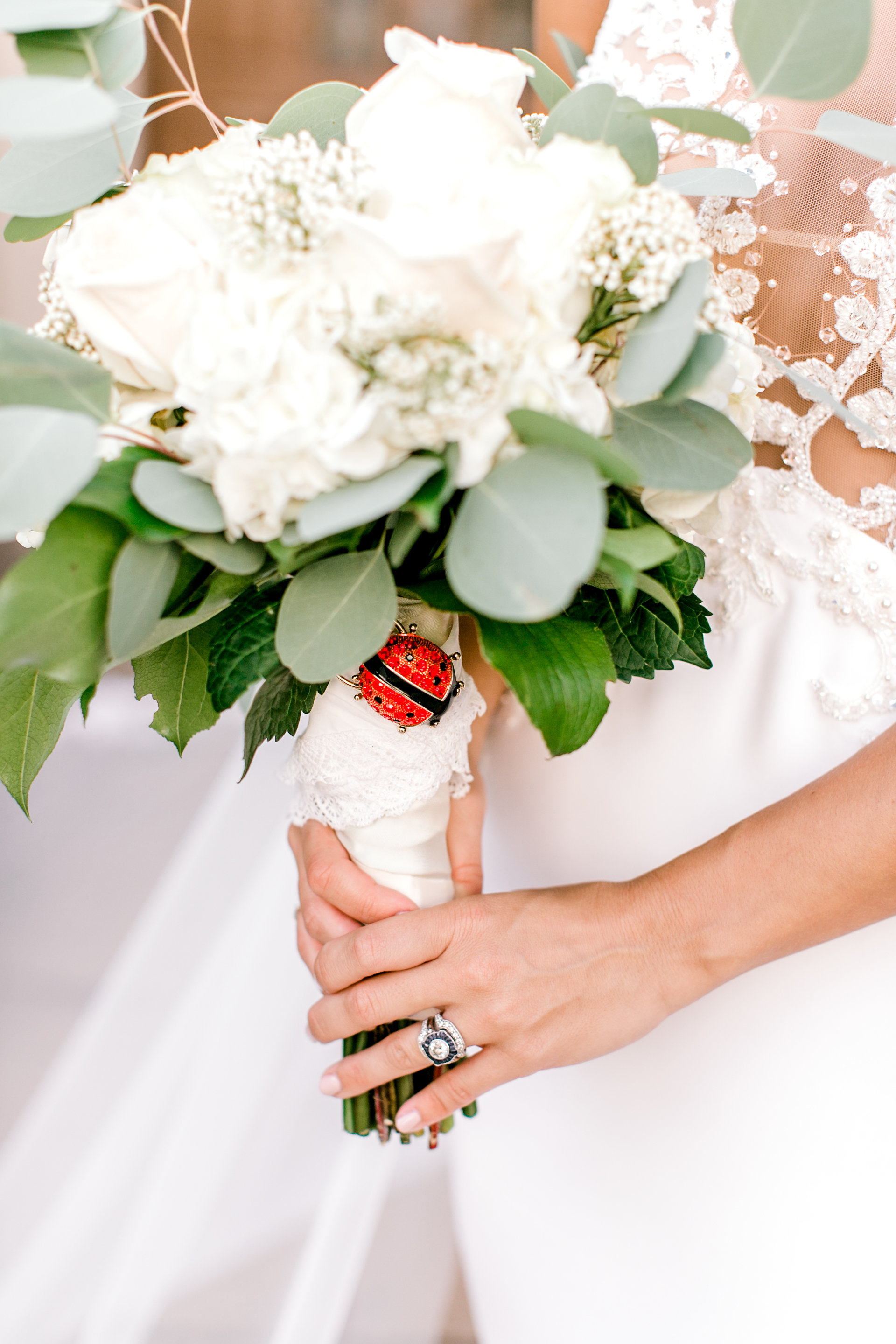 lady bug on white bridal bouquet